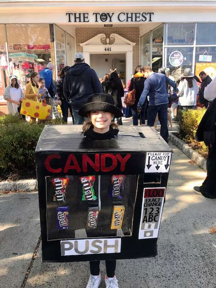 Maddie Scholl, 10, of Ridgefield, dressed as a candy vending machine during the town's annual Halloween Walk on Saturday, Oct. 26. The M&M-themed costume featured six types of the chocolate candies while Maddie trick-or-treated on Main Street. Photo: Contributed Photo