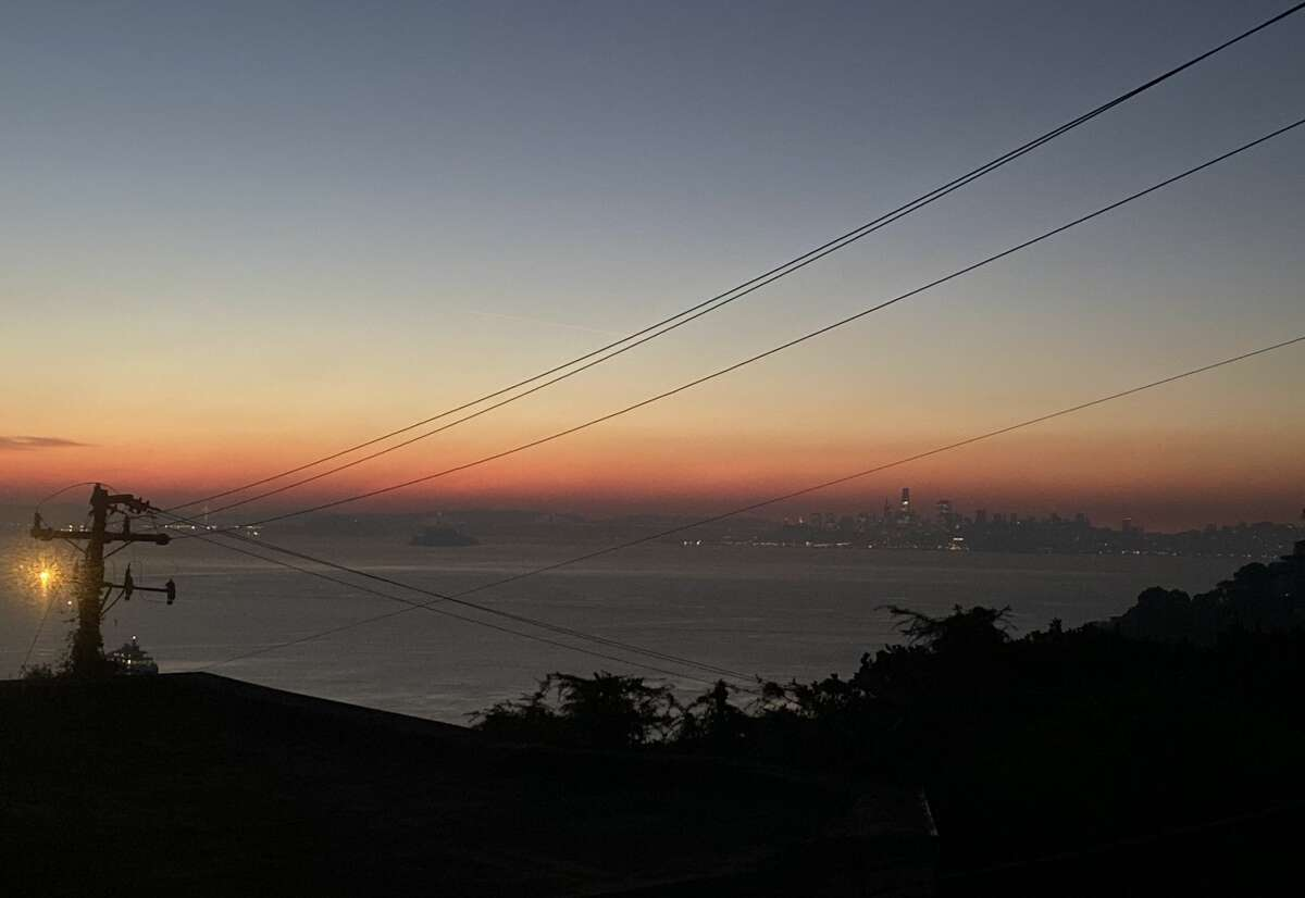Cough-inducing smoke is in the air around the Bay Area on Oct. 28, 2019. Photo take from a darkened Sausalito looking across San Francisco Bay and San Francisco.
