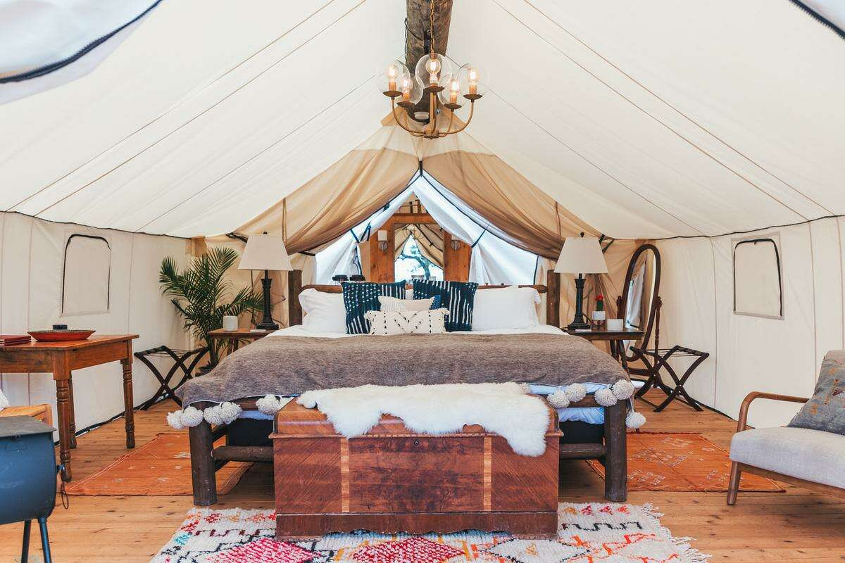 Set on a picturesque ridgeline overlooking Montesino Ranch, Collective Hill Country glampground features 12 elevated, safari-style tents that sleep two (four with roll-away beds) and have private, en suite bathrooms.