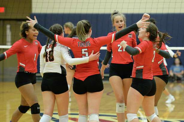 The Tigers celebrate a point during the second set of a volleyball match between the Tompkins Falcons and the Travis Tigers on Tuesday, August 6, 2019 at the Travis HS, Katy, TX.