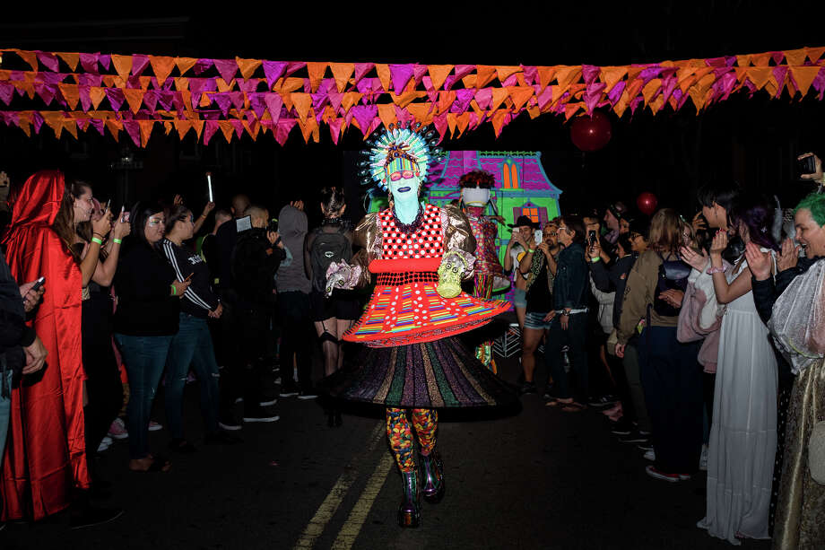 Attendees celebrate Halloween in the Castro for Glow in the Streets block party. Saturday, October 26th, 2019. Photo: Alex Nicholson / SFGate