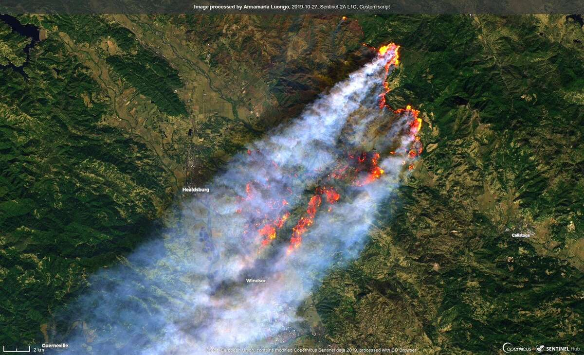 This image taken Sunday by the Sentinel-2A satellite shows the Kincade Fire spreading southwest toward the Sonoma County towns of Healdsburg and Windsor. The smoke plume extends to the Pacific Ocean.