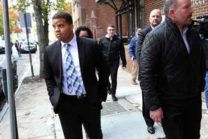 Hamden Police Officer Devin Eaton, left, walks down Church Street following an arraignment in Superior Court in New Haven on charges of first-degree assault and two counts of first-degree reckless endangerment on Oct. 28, 2019.