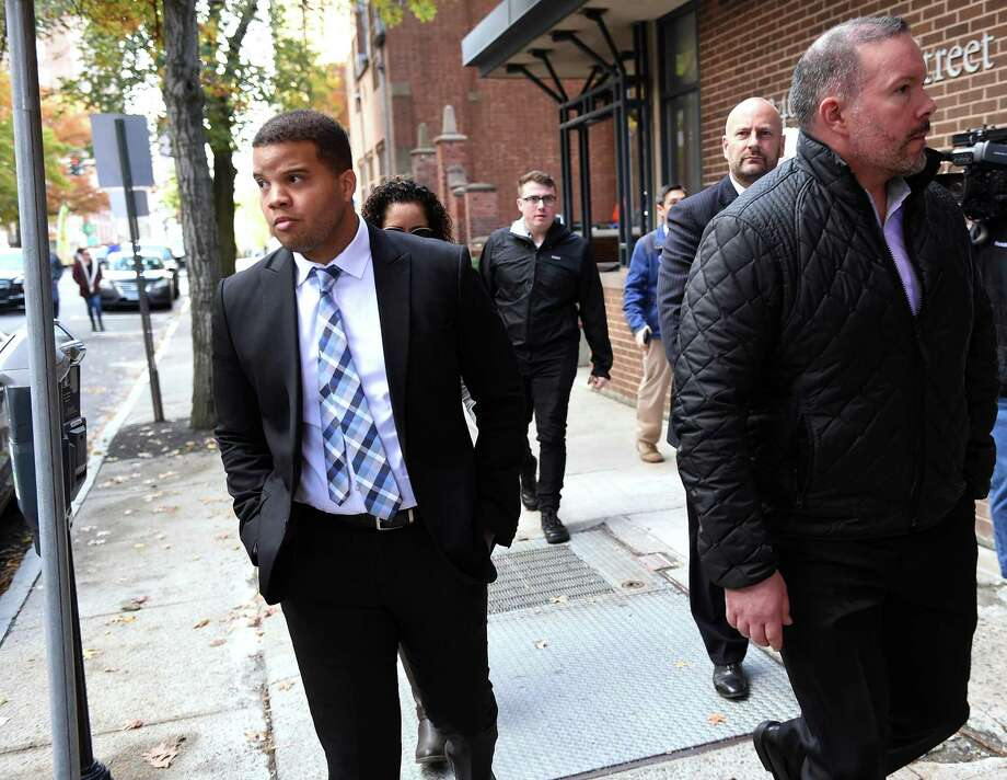 Hamden Police Officer Devin Eaton (left) walks down Church Street following an arraignment in Superior Court in New Haven on charges of first degree assault and two counts of first degree reckless endangerment on October 28, 2019. Photo: Arnold Gold / Hearst Connecticut Media / New Haven Register