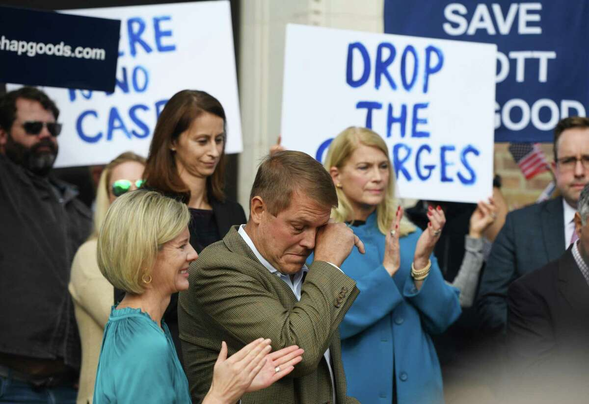 Darien man Scott Hapgood wipes away a tear beside his wife, Kallie Hapgood, at Town Hall in Darien on Monday, as U.S. Sen. Richard Blumenthal, D-Conn., and the town show support for him in his manslaughter trial from a family vacation in Anguilla. Hapgood is facing a manslaughter charge regarding the death of a man who the family says attacked Hapgood in his hotel, forcing him to defend himself and his family.