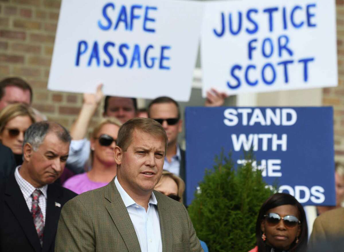 Darien man Scott Hapgood speaks at Town Hall in Darien, Conn. Monday, Oct. 28, 2019 as U.S. Sen. Richard Blumenthal, D-Conn., and the town show support for him in his manslaughter charge from a family vacation in Anguilla. Hapgood is facing a manslaughter charge regarding the death of a man who the family says attacked Hapgood in his hotel, forcing him to defend himself and his family. A revised autopsy report, based on new toxicology tests, determined the man died from a lethal dose of cocaine and not from injuries he sustained in the fight. U.S. Sen. Blumenthal, Darien First Selectman Jayme Stevenson, and friends and family are asking for a fair and transparent trial, as well as guaranteed safe passage, as Hapgood returns to Anguilla to face charges.