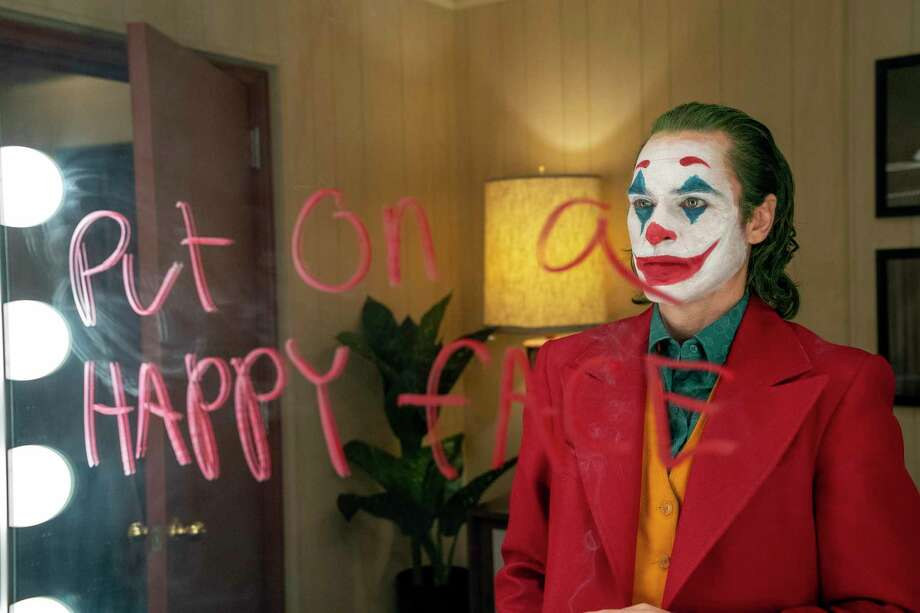 """Joaquin Phoenix's """"Joker"""" brought fans back to theaters last weekend. Photo: Niko Tavernise /Associated Press / Warner Bros. Pictures"""