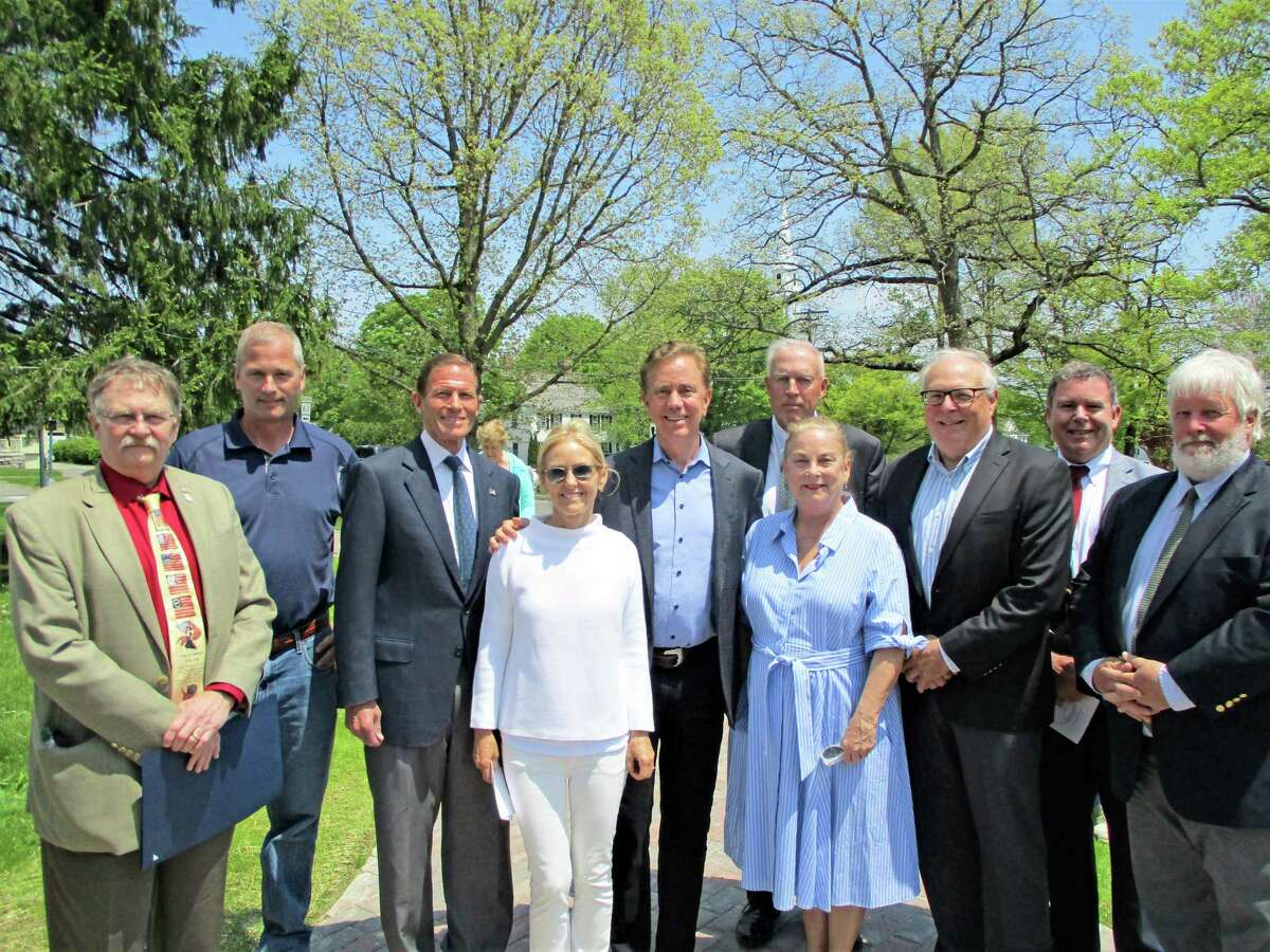 Above, a group gathers during Litchfield's 300th anniversary celebration's opening ceremony in 2019. From left are state Rep. David T. Wilson, Morris First Selectman Tom Weik, U.S. Sen. Richard Blumenthal, Gov. Ned Lamont and Annie Lamont, Second Selectman Jonathan Torrant, who was also the Chair of the 300th Anniversary Committee. Selectman Anne Dranginis, Selectman Jeffrey Zullo, Selectman Paul Parsons and state Sen. Craig Miner.
