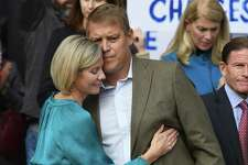 Darien man Scott Hapgood hugs his wife, Kallie Hapgood, at Town Hall in Darien, Conn. Monday, Oct. 28, 2019 as U.S. Sen. Richard Blumenthal, D-Conn., and the town show support for him in his manslaughter charge from a family vacation in Anguilla. Hapgood is facing a manslaughter charge regarding the death of a man who the family says attacked Hapgood in his hotel, forcing him to defend himself and his family. A revised autopsy report, based on new toxicology tests, determined the man died from a lethal dose of cocaine and not from injuries he sustained in the fight. U.S. Sen. Blumenthal, Darien First Selectman Jayme Stevenson, and friends and family are asking for a fair and transparent trial, as well as guaranteed safe passage, as Hapgood returns to Anguilla to face charges.