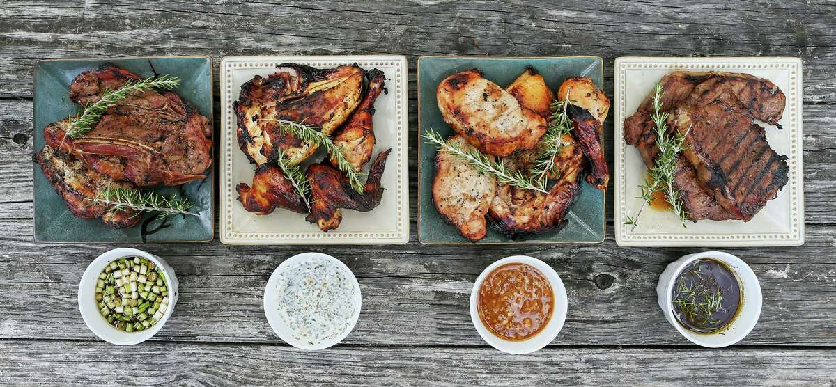 From left: Grilled New York strip steaks marinated in Best Steak Marinade, grilled chicken and pork chops marinated in Pineapple Marinade, grilled chicken marinated in Buttermilk Chicken Marinade and grilled lamb chop and pork chops marinated in Chardonnay Marinade at Chuck's Food Shack