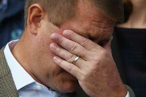 Darien man Scott Hapgood wipes away a tear beside his wife, Kallie Hapgood, at Town Hall in Darien, Conn. Monday, Oct. 28, 2019 as U.S. Sen. Richard Blumenthal, D-Conn., and the town show support for him in his manslaughter charge from a family vacation in Anguilla. Hapgood is facing a manslaughter charge regarding the death of a man who the family says attacked Hapgood in his hotel, forcing him to defend himself and his family. A revised autopsy report, based on new toxicology tests, determined the man died from a lethal dose of cocaine and not from injuries he sustained in the fight. U.S. Sen. Blumenthal, Darien First Selectman Jayme Stevenson, and friends and family are asking for a fair and transparent trial, as well as guaranteed safe passage, as Hapgood returns to Anguilla to face charges.
