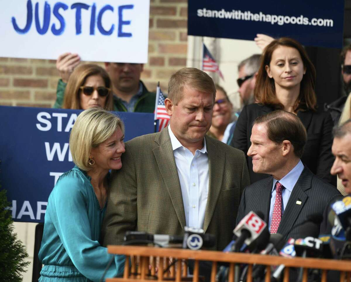 Darien man Scott Hapgood, center, and his wife, Kallie Hapgood, thank U.S. Sen. Richard Blumenthal, D-Conn., for his support after speaking at Town Hall in Darien, Conn. Monday, Oct. 28, 2019. Hapgood is facing a manslaughter charge regarding the death of a man who the family says attacked Hapgood in his hotel, forcing him to defend himself and his family. A revised autopsy report, based on new toxicology tests, determined the man died from a lethal dose of cocaine and not from injuries he sustained in the fight. U.S. Sen. Blumenthal, Darien First Selectman Jayme Stevenson, and friends and family are asking for a fair and transparent trial, as well as guaranteed safe passage, as Hapgood returns to Anguilla to face charges.