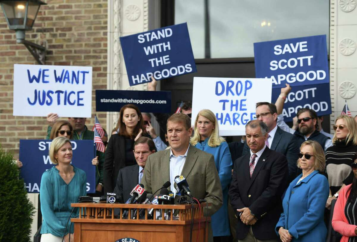 Darien man Scott Hapgood speaks at Town Hall in Darien, Conn. Monday, Oct. 28, 2019 as U.S. Sen. Richard Blumenthal, D-Conn., and the town show support for him in his manslaughter charge from a family vacation in Anguilla. Hapgood is facing a manslaughter charge regarding the death of a man who the family says attacked Hapgood in his hotel, forcing him to defend himself and his family. A revised autopsy report, based on new toxicology tests, determined the man died from a lethal dose of cocaine and not from injuries he sustained in the fight.