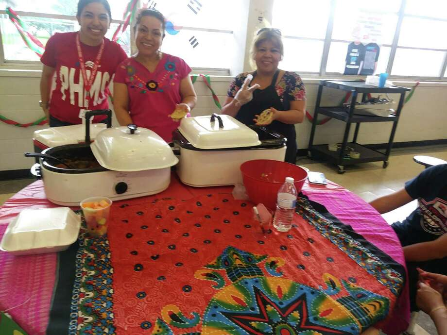 Students and parents from Patrick Henry Middle School prepare a culturally themed dinner to raise funds for students to travel to Europe in July. Photo: Courtesy Photo
