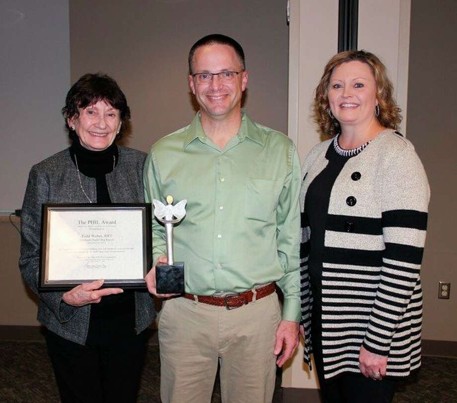 Spectrum Health Big Rapids Hospital respiratory therapist Todd Weber received the Spectrum Health 2019 PHIL award for outstanding respiratory care. Sharman Lamka, founder of the award, is at left, and Shyla Allers, respiratory care supervisor for Spectrum Big Rapids and Reed City hospitals, is at right. (Courtesy photo)