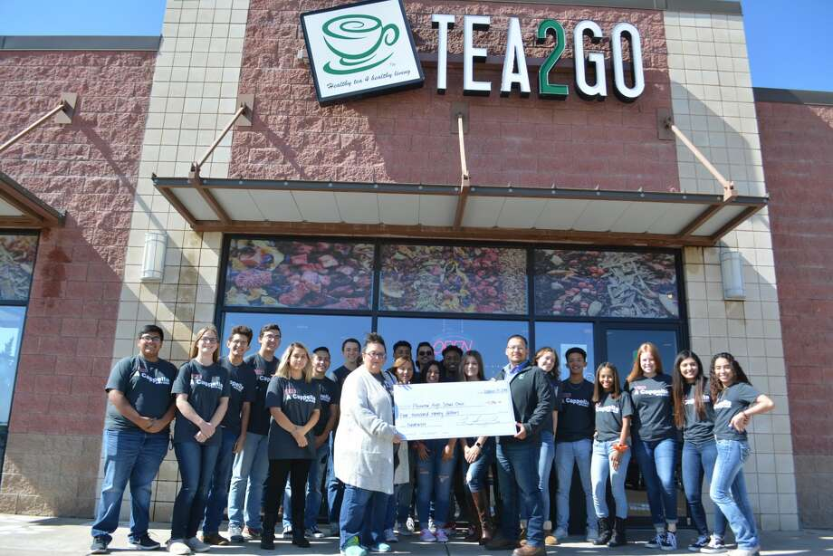 Tea2Go employees presented a check to Plainview High School choir students to help them raise money for a trip to Washington D.C. Photo: Ian Kirk/For The Herald