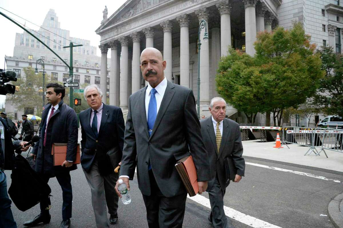 Ted Wells, Jr., the lead attorney for Exxon Mobil, leaves New York State Supreme Court in Manhattan on Tuesday, Oct. 22, 2019. After four years of legal sparring and finger-pointing, oil-industry giant Exxon Mobil went to court on Tuesday to face charges that the company lied to shareholders and to the public about the costs and consequences of climate change. (Jefferson Siegel for The New York Times)
