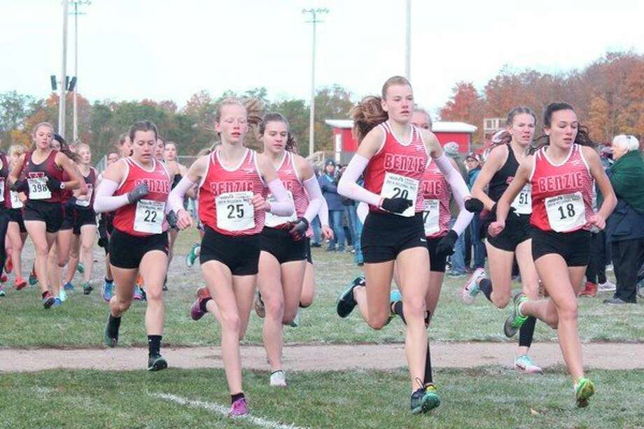 Benzie Central's girls cross country runners run as a pack to take the early race lead. (Photo/Robert Myers)