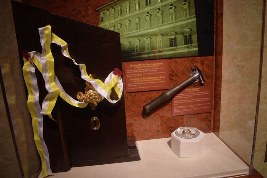 An entire exhibit of the National Museum of Funeral History is dedicated to the death of Pope John Paul II, featuring original equipment used during the ritual of putting a pope to rest. Photo: Chevall Pryce