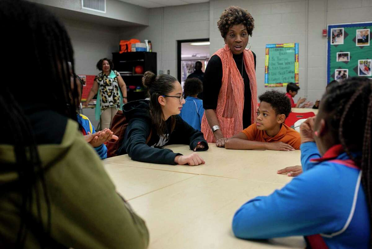 Dr. Dianna Burns-Banks, a San Antonio pediatrician, instructs students during an after school program at East Side Boys and Girls Club in San Antonio, Texas, Oct. 21, 2019. She's a member of the San Antonio chapter of The Links Inc., which is working with middle school students every other week to promote literacy and educate them on the election process.