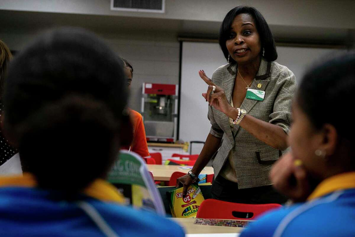 Former San Antonio mayor Ivy Taylor talks with students about the next step of an activity during an after school program at East Side Boys and Girls Club in San Antonio, Texas, Oct. 21, 2019. The program is organized by the San Antonio chapter of The Links Inc., whose members are working with middle school students every other week to promote literacy and educate them on the election process.
