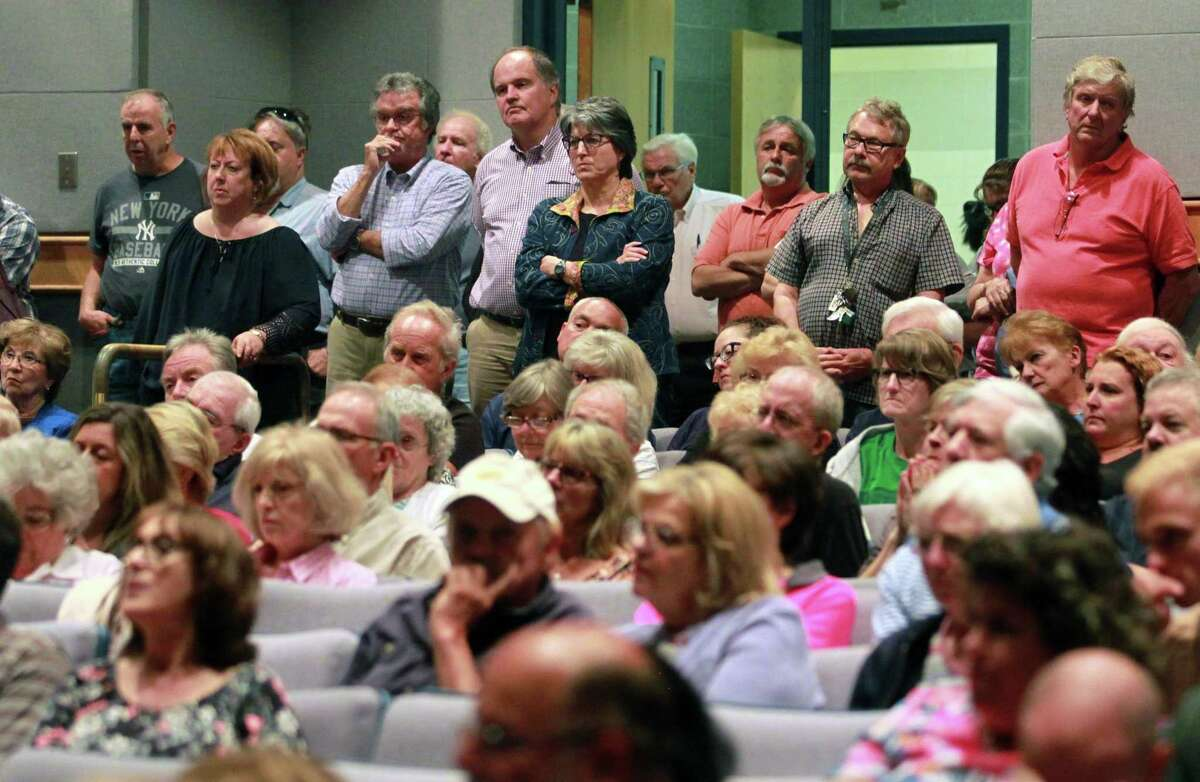 It was standing room only for residents attending Shelton Planning and Zoning Commission's public hearing on a proposed development at Shelton Intermediate School in Shelton, Conn., on Wednesday June 27, 2018. The proposed housing cluster on 6 acres has caused hundreds of residents to voice their opposition to the project.