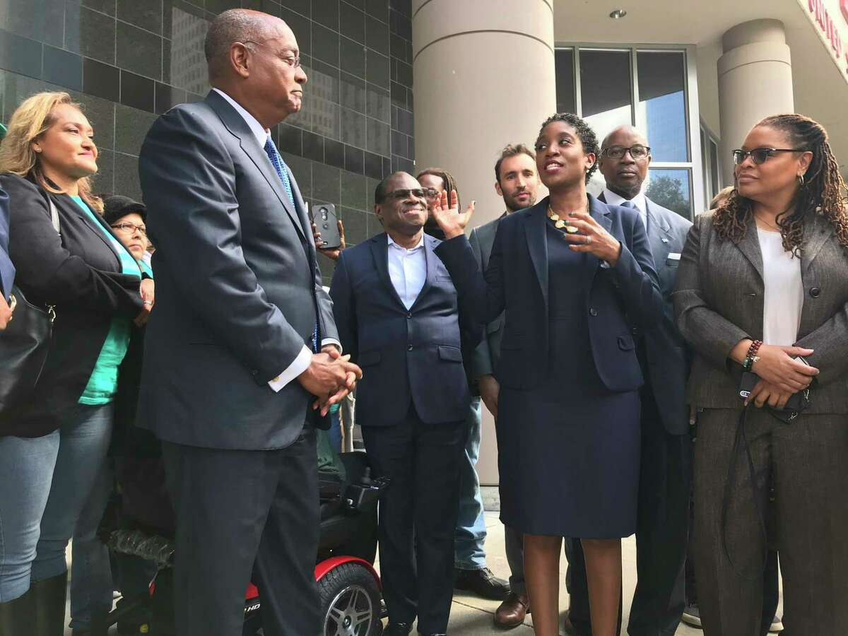 Harris County Court at Law Judge Genesis Draper addresses her concerns with the old bail system that had disparate outcomes for racial minorities as Commissioner Rodney Ellis, who actively backed the bail challenge, listens during a press debriefing outside the federal courthouse in Houston on Monday, Oct. 28, 2019.