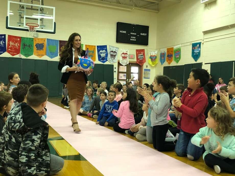 Mohegan School third grade teacher Tina Taylor shows off her class' pumpkin. Photo: Brian Gioiele / Hearst Connecticut Media / Connecticut Post