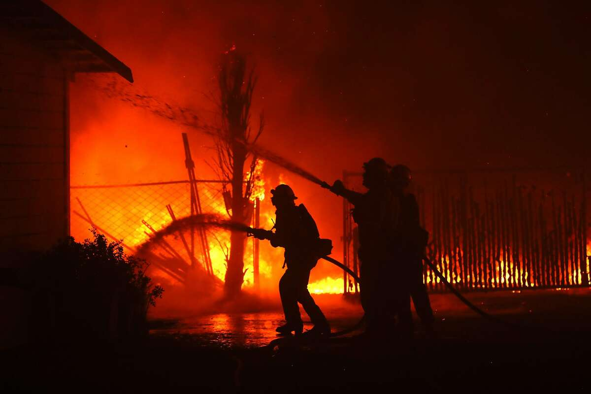 SANTA ROSA, CALIFORNIA - OCTOBER 27: Firefighters battle the Kincade Fire as it burns a barn on October 27, 2019 in Santa Rosa, California. Fueled by high winds, the Kincade Fire has burned over 30,000 acres and has prompted nearly 200,000 evacuations in Sonoma County and beyond. (Photo by Justin Sullivan/Getty Images)