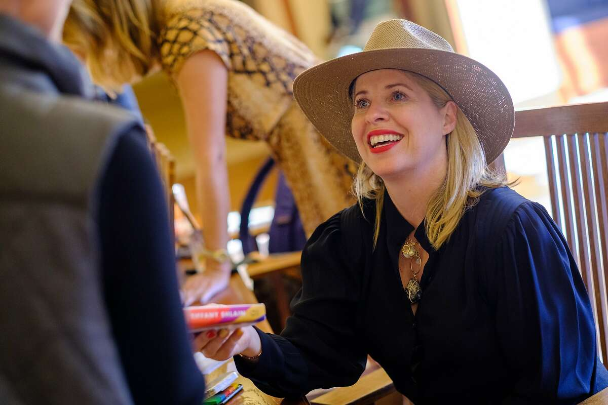 """Author Tiffany Shlain signs copies of her new book, """"24/6: The Power of Unplugging One Day a Week"""" at The What Summit. Oct. 17, 2019."""