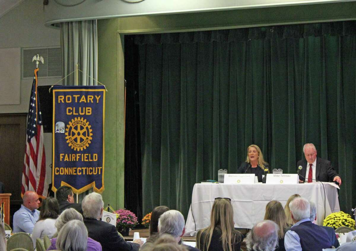 Brenda Kupchick and Mike Tetreau debated at the Rotary Club's First Selectman candidate forum Monday.