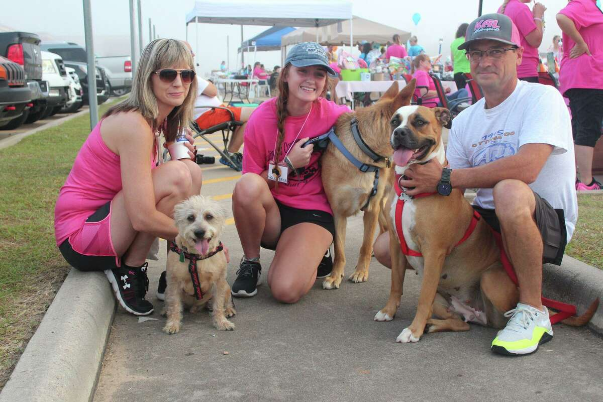 People pose with pets for photos during a previous event hosted by Juliane's Compassion for Critters. This year's fundraiser will be held online.