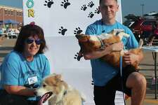 People pose with pets for photos during a previous event hosted by Juliane's Compassion for Critters.