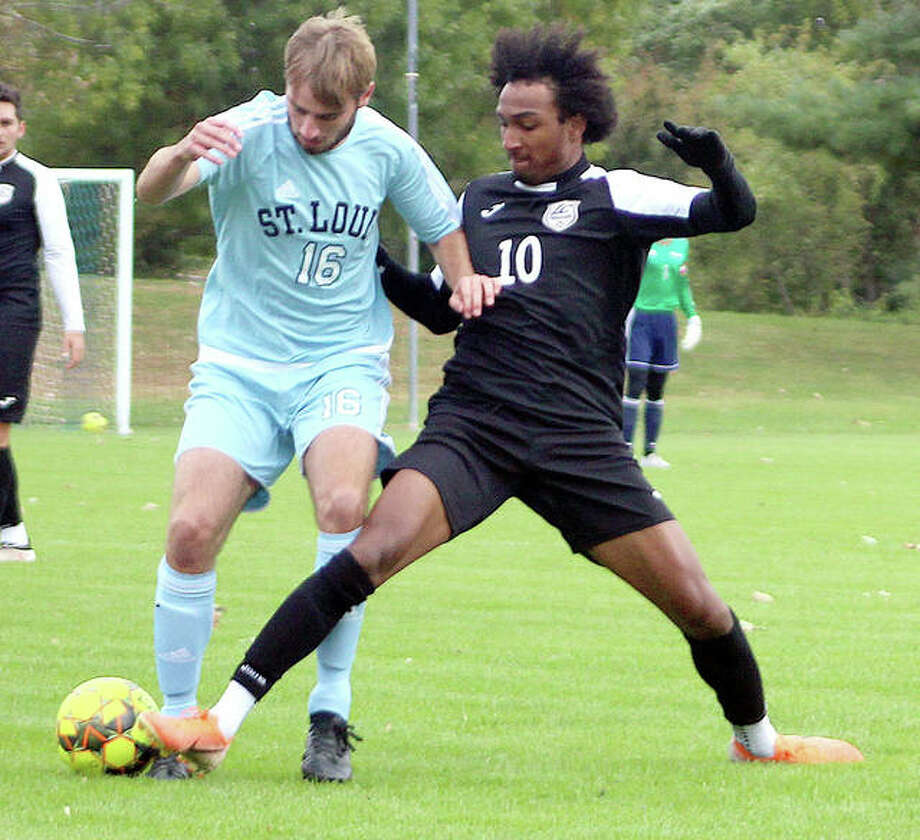 Reshaun Walkes of LCCC (10) battles for the ball with STLCC's James Grainger during a game Oct. 16 in Florissant, Mo. Walkes, an All-America forward, missed Sunday's Region 24 semifinal loss to Heartland with a deep bone bruise after he struck an in-ground sprinkler head in the game against STLCC. Photo: Pete Hayes | The Telegraph