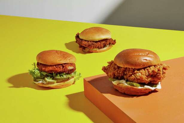 The new Popeyes chicken sandwich, right, with chicken sandwiches from Shake Shack (left) and Chick-Fil-A (top).