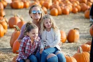 Sandi Staley, Ariana,5, and Alivia, 3, enjoy pumpkin picking at Children's Festival for Unicef at the Jones Family Farm on Saturday, Oct. 26, 2019 in Shelton, Conn.   Sandi Staley, Ariana,5, and Alivia, 3, enjoy pumpkin picking at Children's Festival for Unicef at the Jones Family Farm on Saturday, Oct. 26, 2019 in Shelton, Conn.