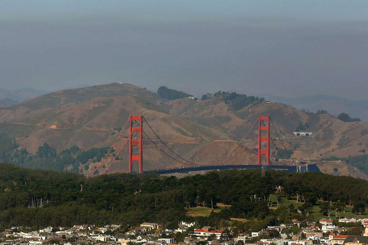 Beyond the Golden Gate Bridge, a layer of haze is seen over the North Bay on Monday, October 28, 2019 in San Francisco, Calif.