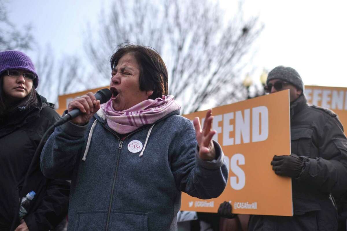 Protesters, including Sara Ramirez, an organizer and speaker, gathered at Lafayette Square in Washington ion January 2018, to denounce a move by the Trump administration that would force nearly 200,000 Salvadorans who have been in the United States since at least 2001 to either obtain a different legal status or leave the country. U.S. officials on Monday reversed course.