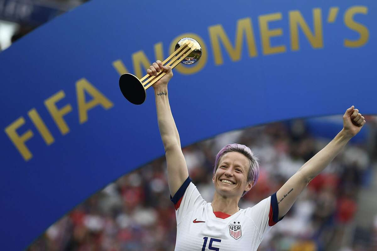 (FILES) In this file photo taken on July 7, 2019 United States' forward Megan Rapinoe poses with the Golden Ball after the France 2019 Womens World Cup football final match between USA and the Netherlands, at the Lyon Stadium in Lyon, central-eastern France. - While Megan Rapinoe is the leading candidate for the second ever women's Ballon D'Or, the holder of the men's award, Luka Modric, and the world's most expensive player Neymar missed out as France Football unveiled nominees in four categories on October 21, 2019. (Photo by CHRISTOPHE SIMON / AFP) (Photo by CHRISTOPHE SIMON/AFP via Getty Images)