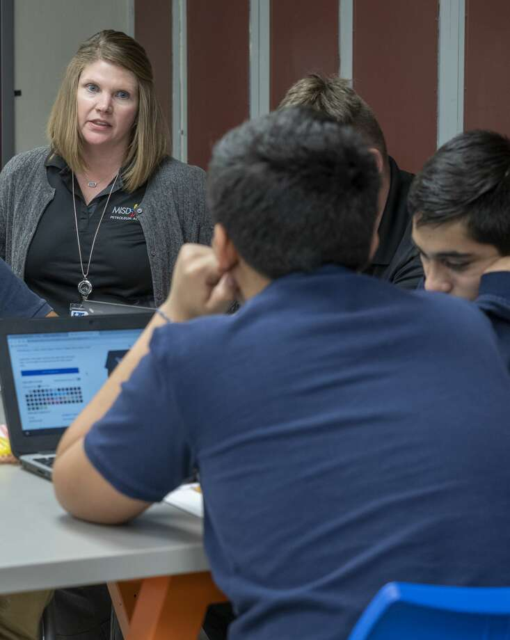 Tammy Ridgway works with her students 10/24/19 at Lee Freshman in the MISD Petroleum Academy. Tim Fischer/Reporter-Telegram Photo: Tim Fischer/Midland Reporter-Telegram
