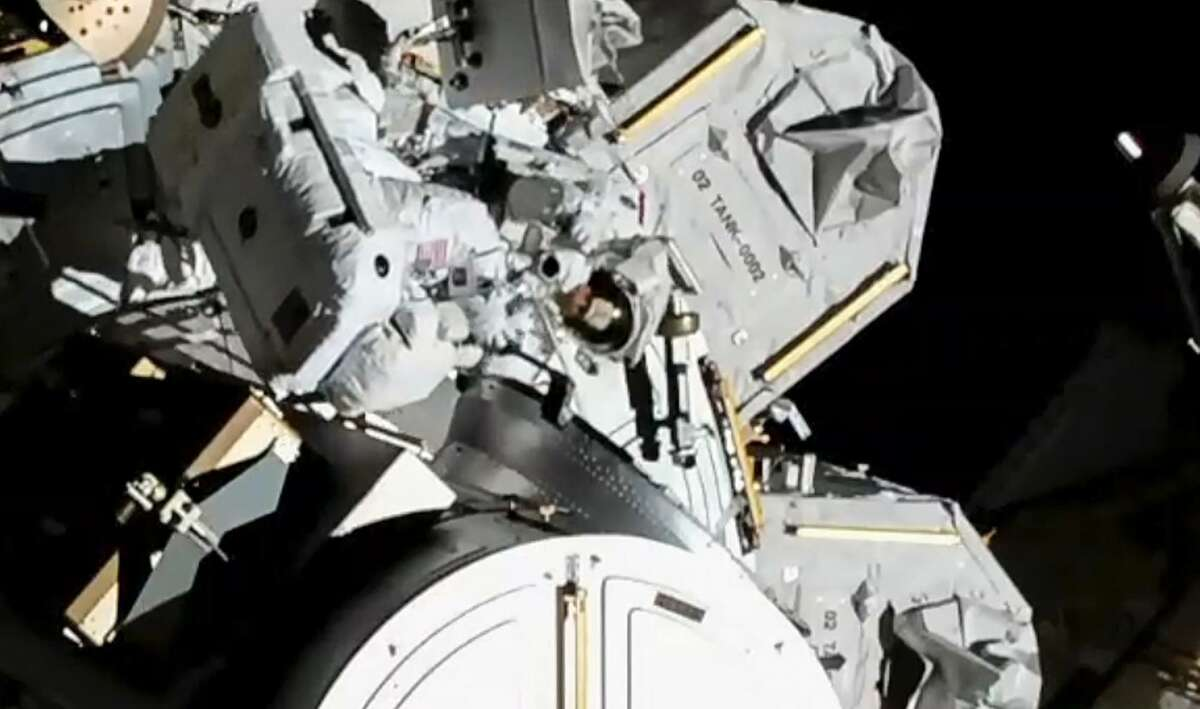 A still image from video provided by NASA shows astronauts Jessica Meir and Christina Koch, near center at the top of the frame, working to replace a power controller outside the International Space Station on Friday, Oct. 18, 2019. NASA reached a milestone on Friday with the first all-female spacewalk. (NASA via The New York Times)