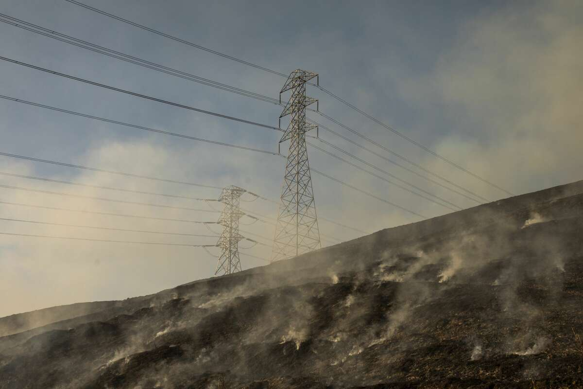 Smokes rises from a back fire set by fire fighters near a hillside near PG&E power lines during firefighting operations to battle the Kincade Fire in Healdsburg on October 26, 2019.
