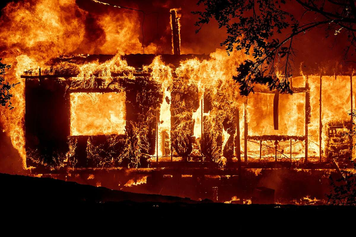 Flames consume a home as the Kincade Fire tears through the Jimtown community of Sonoma County, Calif., Oct. 24, 2019. (AP Photo/Noah Berger)