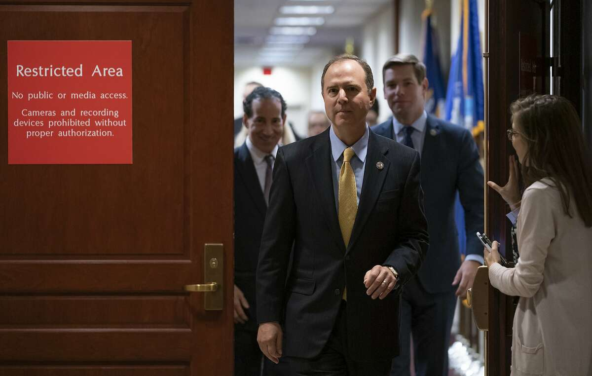 House Intelligence Committee Chairman Adam Schiff, D-Calif., followed by Rep. Jamie Raskin, D-Md., left, and Rep. Eric Swalwell, D-Calif., leaves a secure area at the Capitol to speak to reporters, in Washington, Monday, Oct. 28, 2019. Schiff announced that former deputy national security adviser Charles Kupperman failed to appear to be interviewed in the impeachment inquiry of President Donald Trump as lawmakers try to the determine if the president violated his oath of office by asking a foreign country, Ukraine, to investigate his political opponent, former Vice President Joe Biden, and his son Hunter Biden. (AP Photo/J. Scott Applewhite)