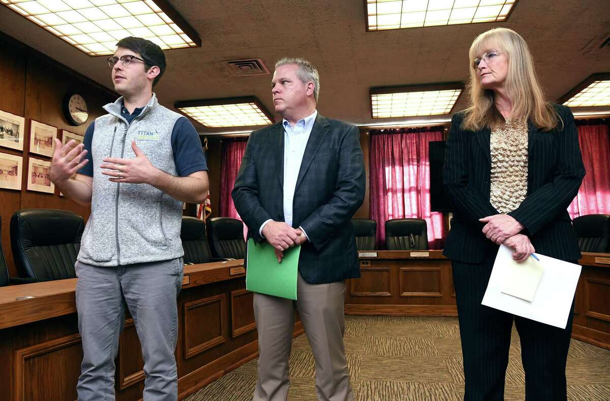 From left, Adam Teff, general manager of Titan Energy, Ken Carney, chairman of the West Haven High School building committee, and Mayor Nancy Rossi hold a press conference Monday at West Haven City Hall to talk about the solar panel project planned for the renovated high school.