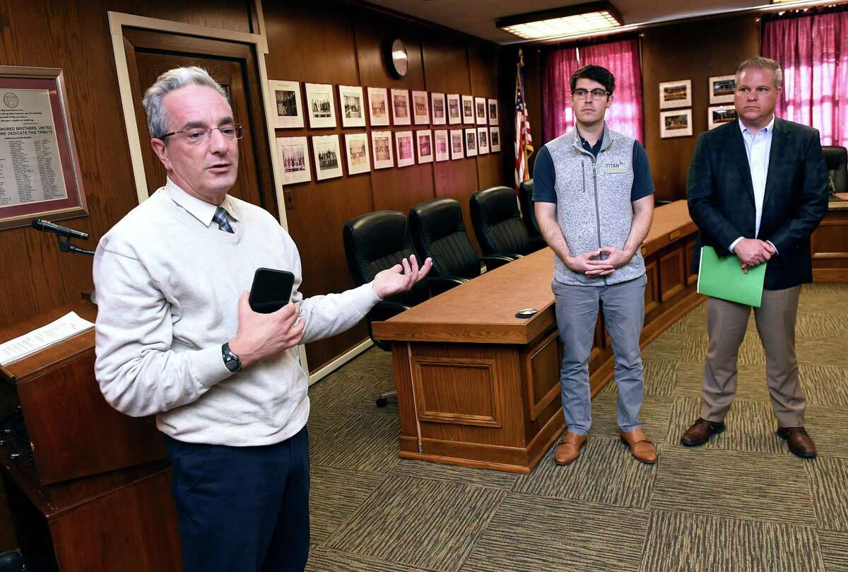 West Haven Superintendent of Schools Neil Cavallaro, left, answers questions during a press conference Monday at West Haven City Hall about the solar panel project planned for the renovated high school. Behind him are Adam Teff, center, general manager of Titan Energy, and Ken Carney, chairman of the West Haven High School building committee.