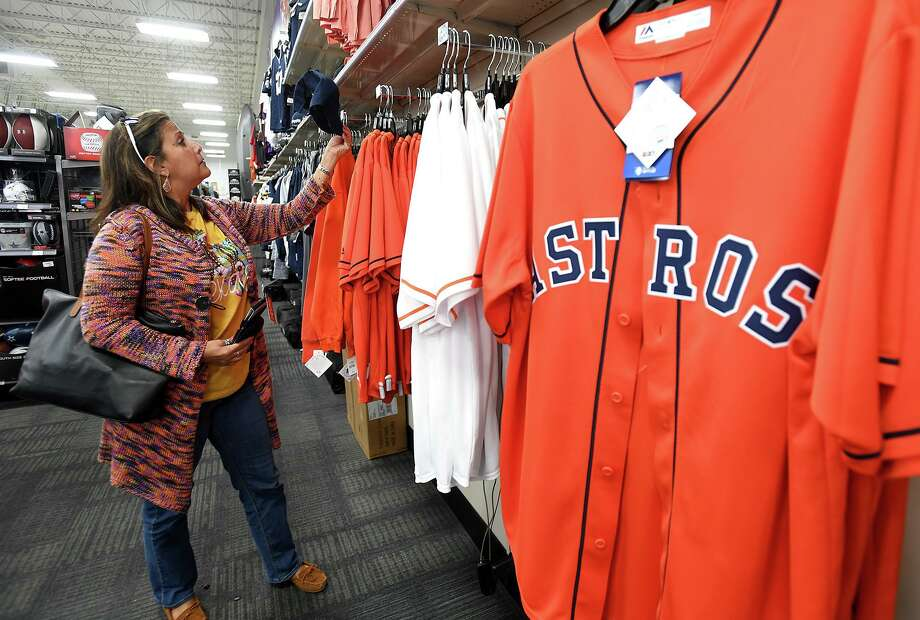 Frances Saleme shops for Astros attire at Beaumont's Academy on Tuesday. The Astros played the Nationals Monday night in the first game of the 2019 World Series. Photo taken Tuesday, 10/22/19 Photo: Guiseppe Barranco/The Enterprise, Photo Editor / Guiseppe Barranco ©