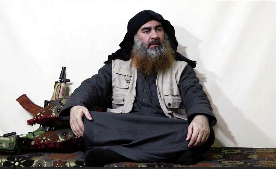 This image made from video posted on a militant website on Monday, April 29, 2019, purports to show the leader of the Islamic State group, Abu Bakr al-Baghdadi, being interviewed by his group's Al-Furqan media outlet. Al-Baghdadi acknowledged in his first video since June 2014 that IS lost the war in the eastern Syrian village of Baghouz that was captured last month by the Kurdish-led Syrian Democratic Forces. (Al-Furqan media via AP) / Al-Furqan media