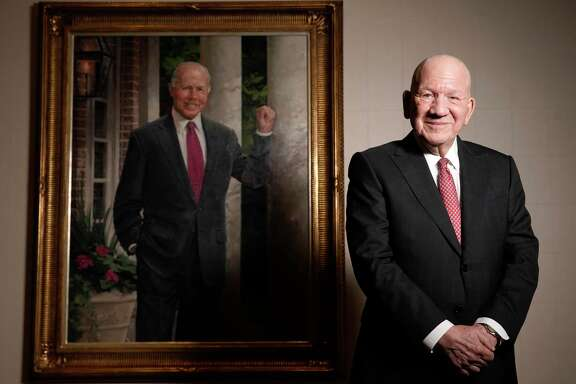 Jim Teague, Enterprise Products Partners CEO, stands with a portrait of the late Dan L. Duncan, who was the company founder.