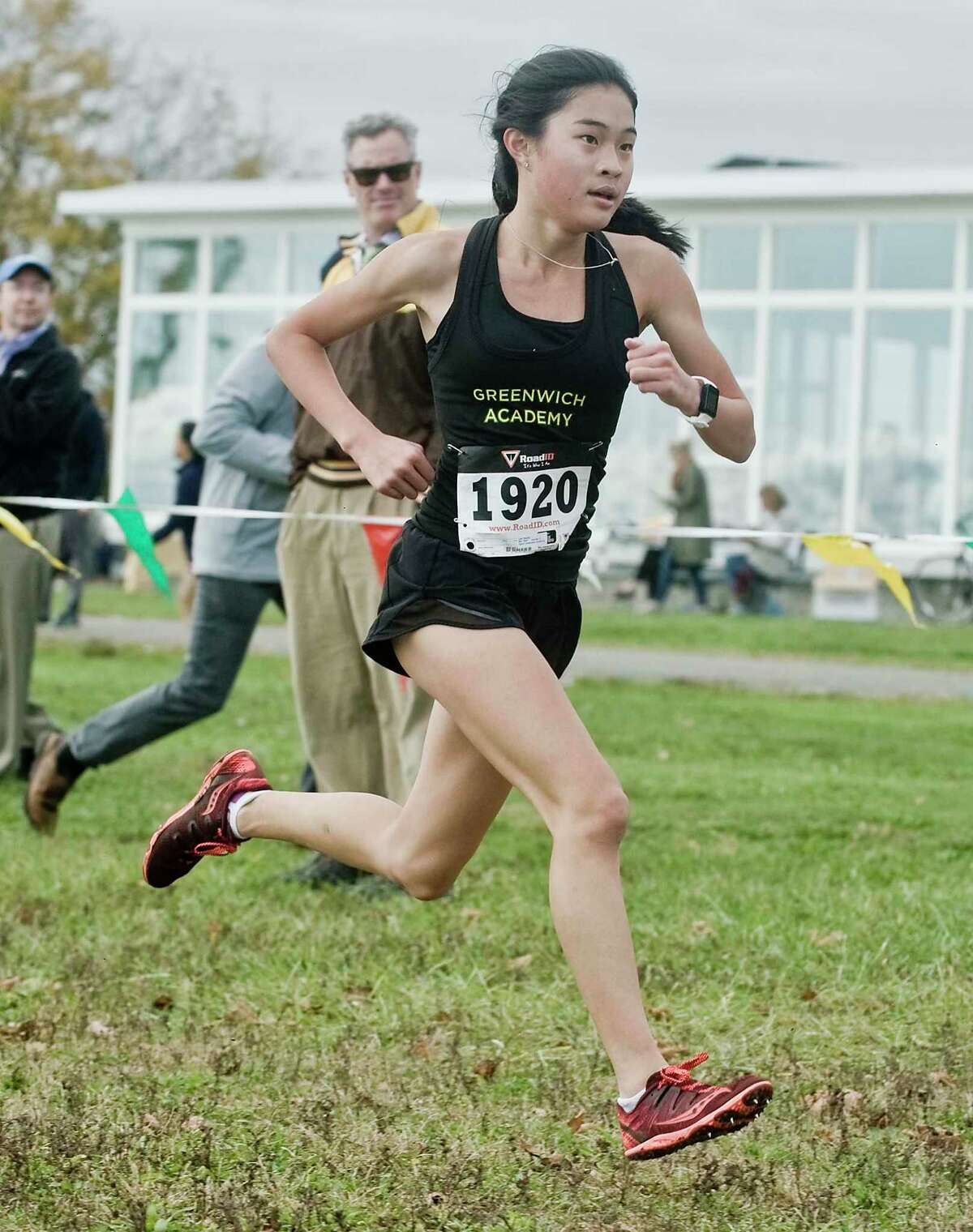 Maddy Lee, of Greenwich Academy, winning the FAA Girls Cross Country Championships at Sherwood Island in Westport. Monday, Oct. 28, 2019